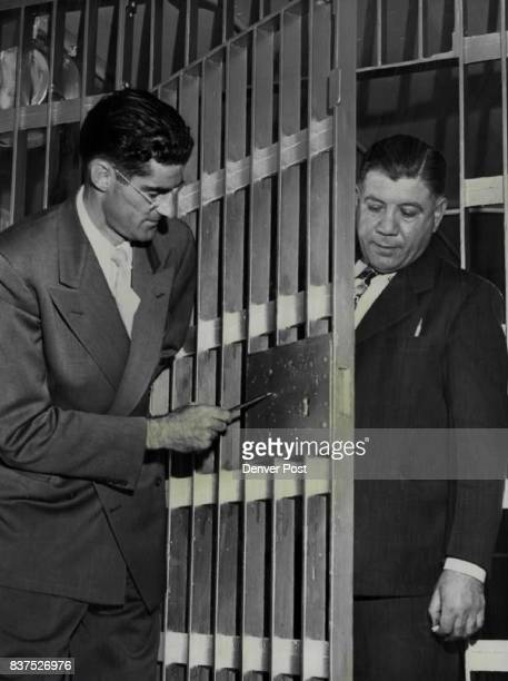 Malcolm E Harris California prison expert looks over the Denver county jail with Warden Steve De Angelis Harris field representative of the...