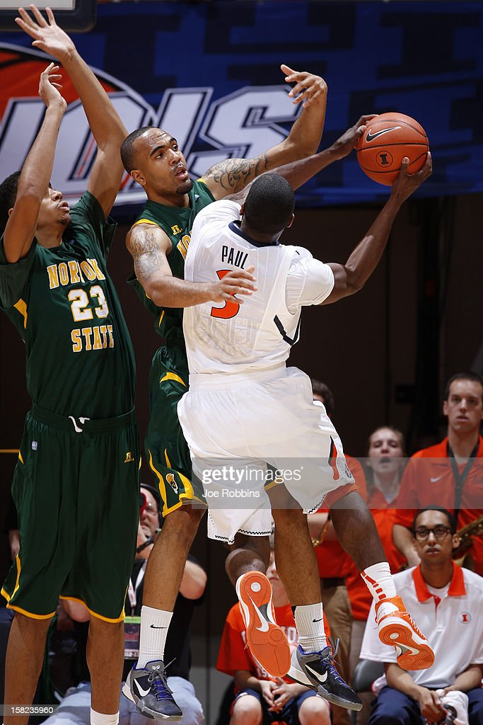 Malcolm Hawkins #25 and Brandon Goode #23 of the Norfolk State Spartans defend against Brandon Paul #3 of the Illinois Fighting Illini during the game at Assembly Hall on December 11, 2012 in Champaign, Illinois. Illinois won 64-54.