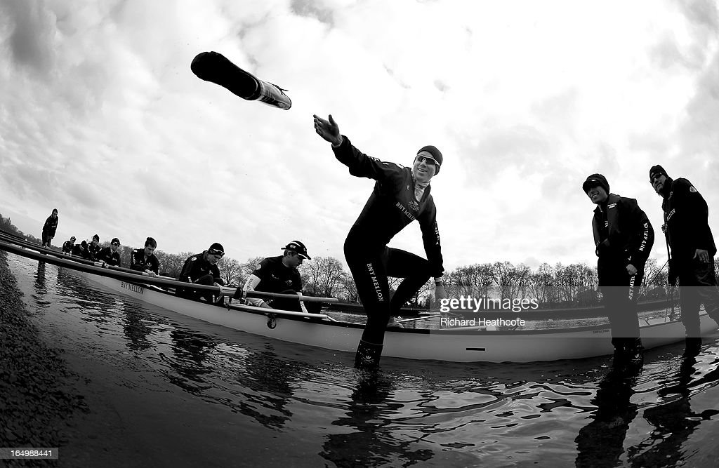 <a gi-track='captionPersonalityLinkClicked' href=/galleries/search?phrase=Malcolm+Howard&family=editorial&specificpeople=2969427 ng-click='$event.stopPropagation()'>Malcolm Howard</a> of Oxford throws his wellies to the shore as they go out on a training outing on The River Thames on March 30, 2013 in London, England. The 159th University Boat Race will take place on Sunday 31st March 2013 from Putney to Mortlake.