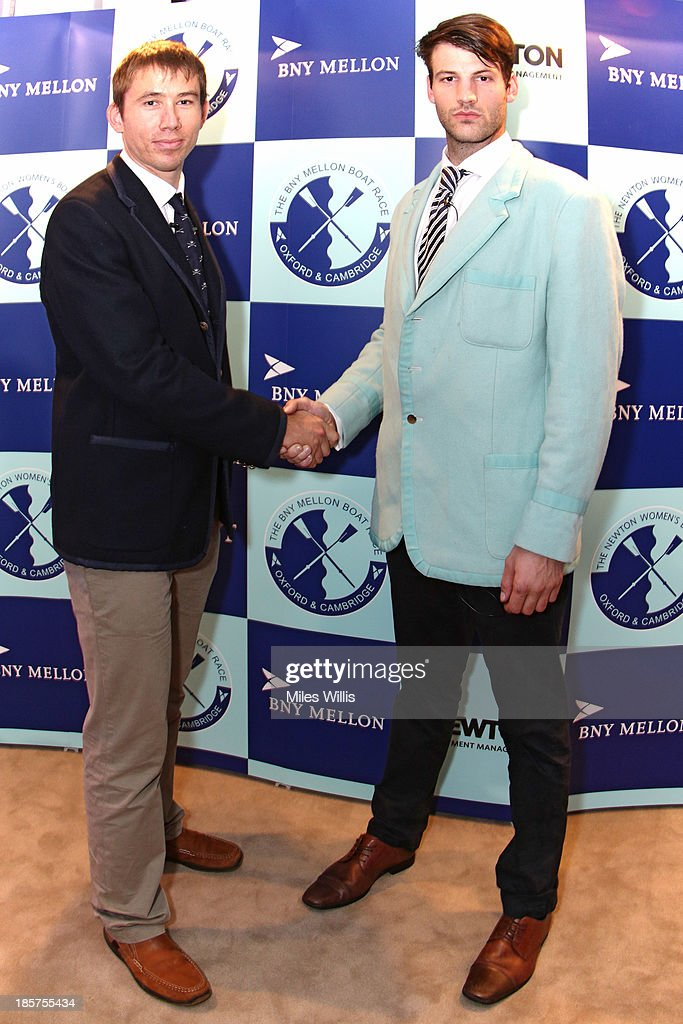 <a gi-track='captionPersonalityLinkClicked' href=/galleries/search?phrase=Malcolm+Howard&family=editorial&specificpeople=2969427 ng-click='$event.stopPropagation()'>Malcolm Howard</a>, President of the Oxford University Boat Club and Steve Dudek, President of the Cambridge University Boat Club shake hands after the official challenge during the BNY Melon University Boat Race Autumn Reception at the BNY Melon offices on 24th October 2013 in London, England.