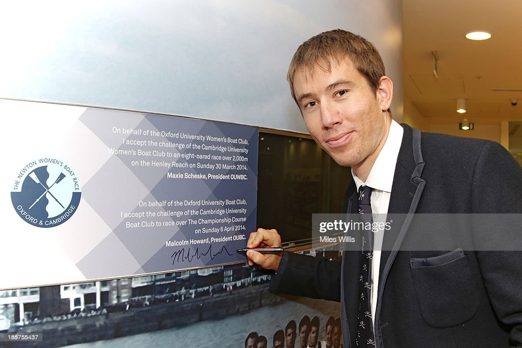 <a gi-track='captionPersonalityLinkClicked' href=/galleries/search?phrase=Malcolm+Howard&family=editorial&specificpeople=2969427 ng-click='$event.stopPropagation()'>Malcolm Howard</a>, President of the Oxford University Boat Club for the 2014 Boat Race campaign signs the wall during the BNY Melon University Boat Race Autumn Reception at the BNY Melon offices on 24th October 2013 in London, England.