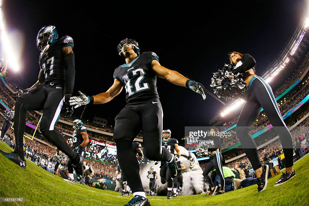 Malcolm Jenkins and Chris Maragos of the Philadelphia Eagles take the field before the stat of a football game against the New York Giants at Lincoln...