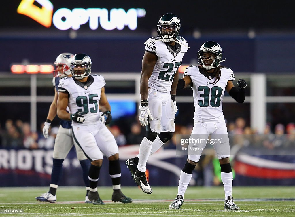 Malcolm Jenkins #27 and E.J. Biggers #38 of the Philadelphia Eagles celebrate after an incomplete New England Patriots pass leading to a turnover on downs during the fourth quarter at Gillette Stadium on December 6, 2015 in Foxboro, Massachusetts.