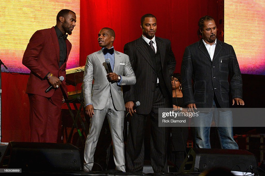 Malcolm Jenkins of the New Orleans Saints, host Kirk Franklin, Darren Sharper former New Orleans Saints player and Jamie Sharper former Baltimore Ravens player speak onstage during the Super Bowl Gospel 2013 Show at UNO Lakefront Arena on February 1, 2013 in New Orleans, Louisiana.