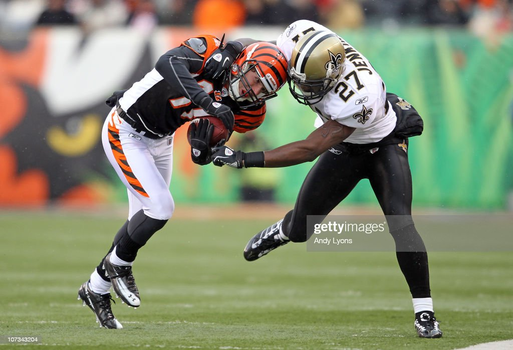 Malcolm Jenkins of the New Orleans Saints tackles Jordan Shipley of the Cincinnati Bengals during the NFL game at Paul Brown Stadium on December 5...