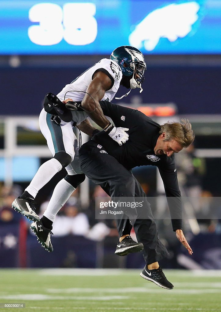 Malcolm Jenkins #27 of the Philadelphia Eagles celebrates with defensive backs coach Cory Undlin after an incomplete New England Patriots pass leading to a turnover on downs during the fourth quarter at Gillette Stadium on December 6, 2015 in Foxboro, Massachusetts.