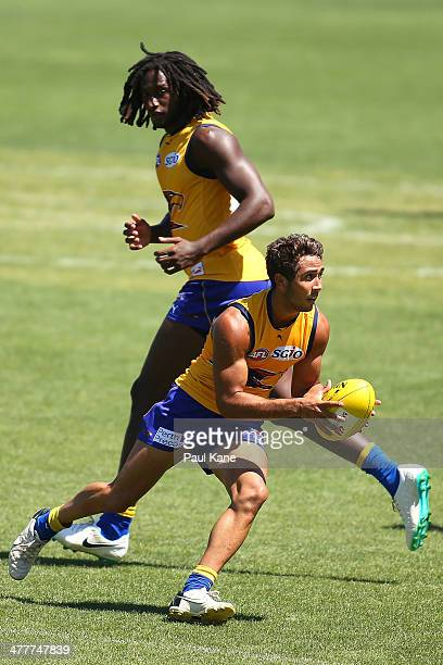 Malcolm Karpany of the Eagles looks to handball during a West Coast Eagles AFL training session at Patersons Stadium on March 11 2014 in Perth...