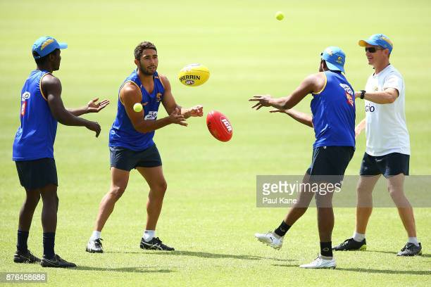 Malcolm Karpany of the Eagles works on a drill with Tarir Bayok and Francis Watson during a West Coast Eagles AFL training session at Lathlain Park...