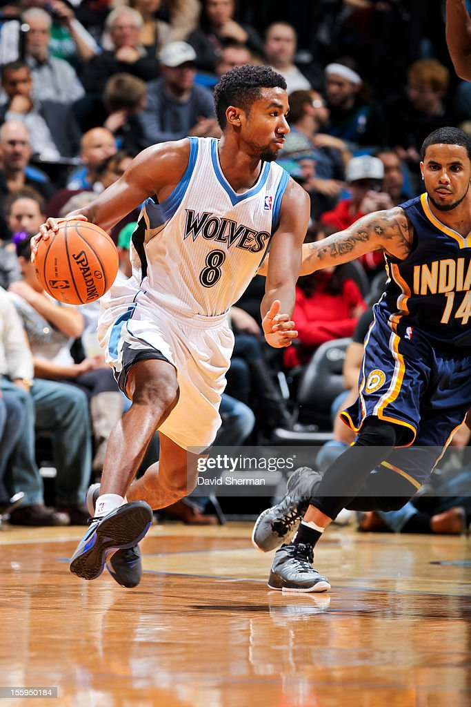 Malcolm Lee #8 of the Minnesota Timberwolves drives against D.J. Augustin #14 of the Indiana Pacers on November 9, 2012 at Target Center in Minneapolis, Minnesota.