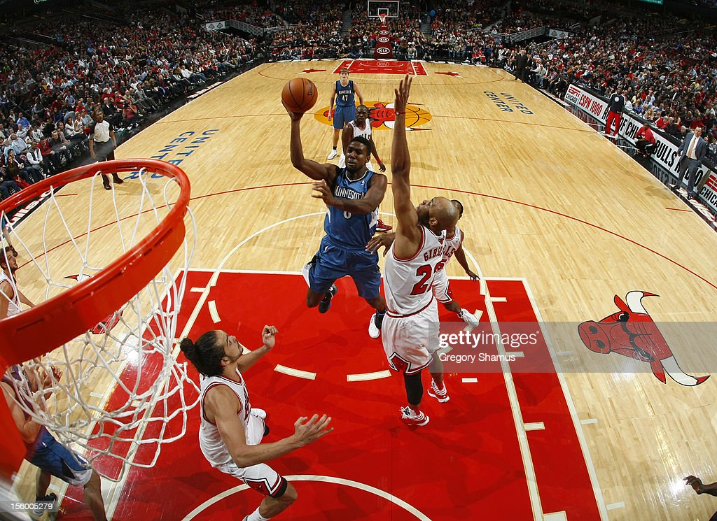 Malcolm Lee #8 of the Minnesota Timberwolves drives to the basket over <a gi-track='captionPersonalityLinkClicked' href=/galleries/search?phrase=Taj+Gibson&family=editorial&specificpeople=4029461 ng-click='$event.stopPropagation()'>Taj Gibson</a> #22 and <a gi-track='captionPersonalityLinkClicked' href=/galleries/search?phrase=Joakim+Noah&family=editorial&specificpeople=699038 ng-click='$event.stopPropagation()'>Joakim Noah</a> #13 of the Chicago Bulls on November 10, 2012 at the United Center in Chicago, Illinois.