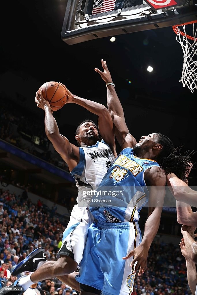 Malcolm Lee #8 of the Minnesota Timberwolves goes to the basket against Kenneth Faried #35 of the Denver Nuggets during the game between the Minnesota Timberwolves and the Denver Nuggets on November 21, 2012 at Target Center in Minneapolis, Minnesota.