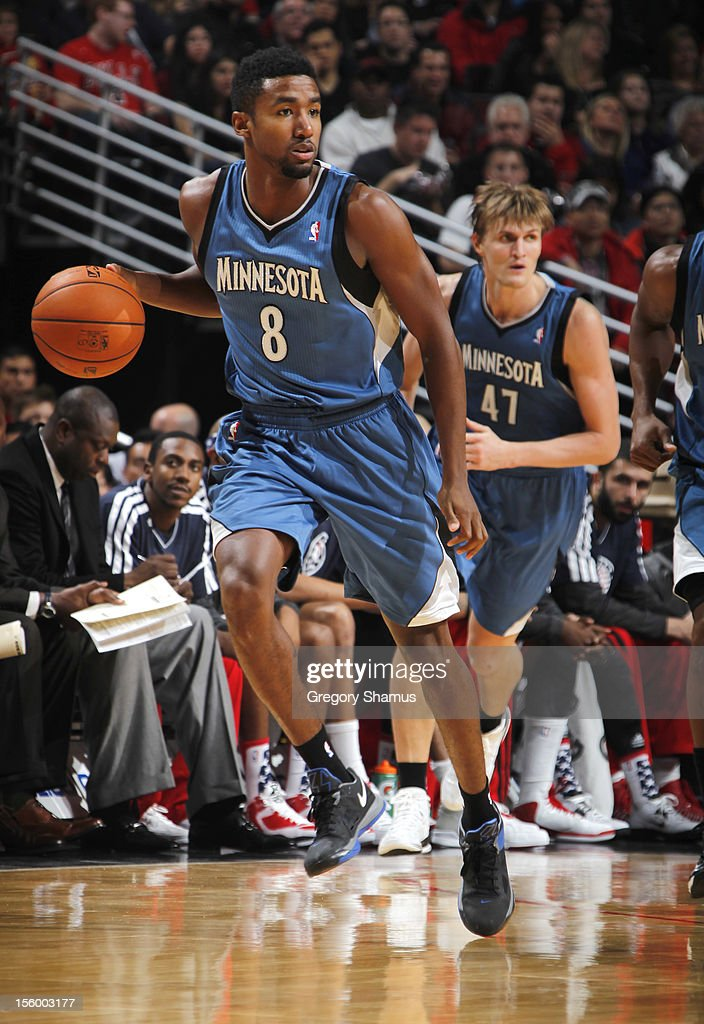 Malcolm Lee #8 of the Minnesota Timberwolves moves the ball upcourt past teammate Andrei Kirilenko #47 during the game against the Chicago Bulls on November 10, 2012 at the United Center in Chicago, Illinois.