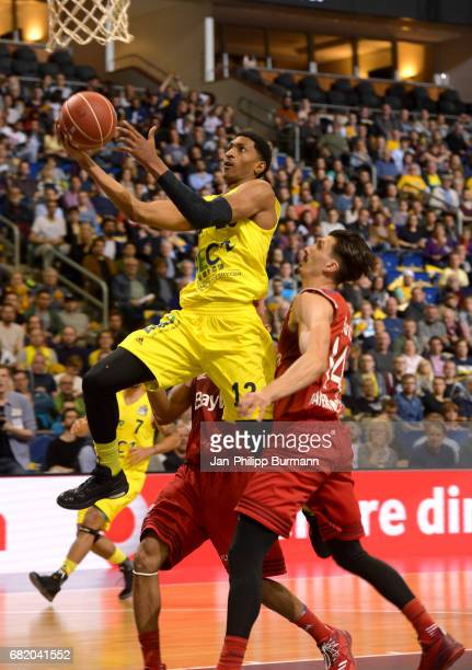 Malcolm Miller of Alba Berlin and Nihad Dedovic of FC Bayern Muenchen during the easyCredit BBL match between Alba Berlin and FC Bayern Muenchen on...