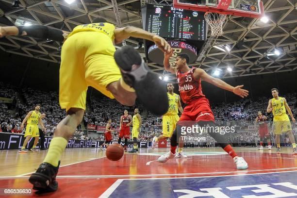 Malcolm Miller of Berlin und Karim Jallow of Munich battle for the ball during the easyCredit BBL Basketball Bundesliga match between FC Bayern...