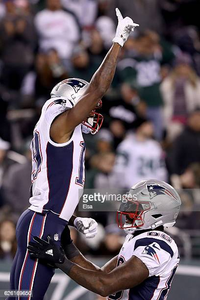 Malcolm Mitchell of the New England Patriots celebrates with Martellus Bennett after scoring a touchdown against the New York Jets during the second...