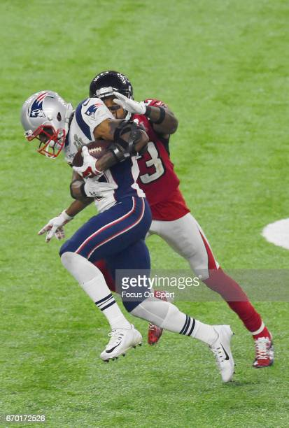 Malcolm Mitchell of the New England Patriots gets tackled by Robert Alford of the Atlanta Falcons during Super Bowl 51 at NRG Stadium on February 5...