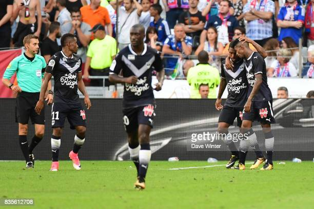 Malcolm Silva de Oliveira of Bordeaux is congratulated on his late equaliser during the Ligue 1 match between Olympique Lyonnais and FC Girondins de...