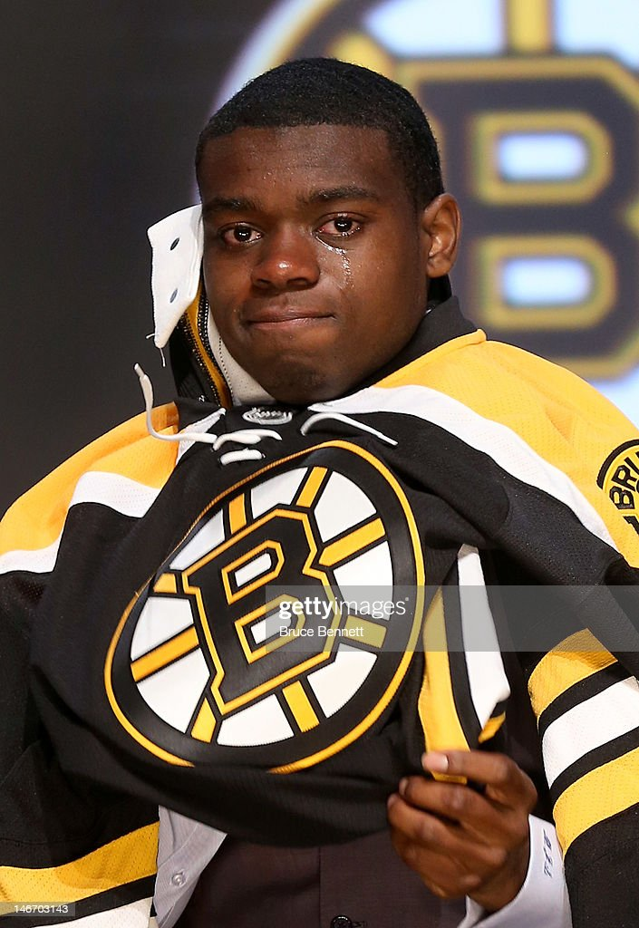 Malcolm Subban, 24th overall pick by the Boston Bruins, cries as he puts on his jersey during Round One of the 2012 NHL Entry Draft at Consol Energy Center on June 22, 2012 in Pittsburgh, Pennsylvania.