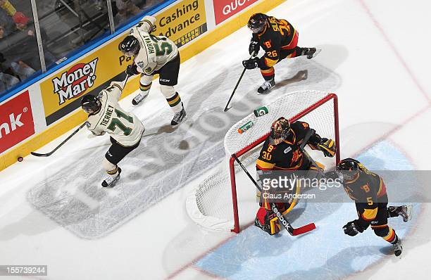 Malcolm Subban of the Belleville Bulls keeps an eye on the play behind the net in an OHL game against the London Knights on November 2 2012 at the...