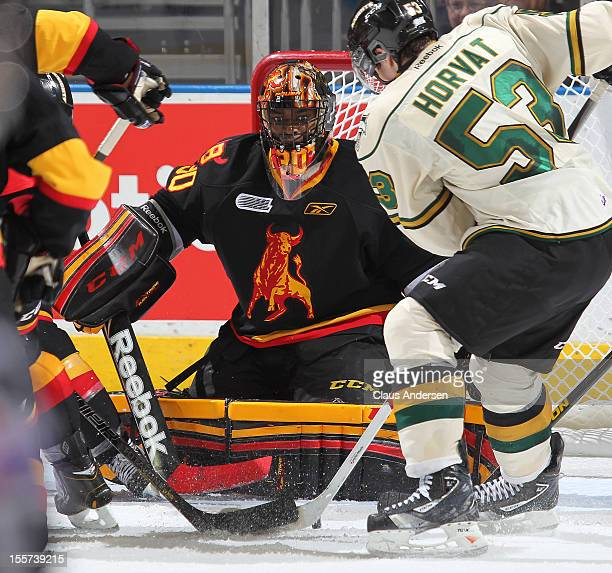 Malcolm Subban of the Belleville Bulls keeps his eye on a loose puck in an OHL game against the London Knights on November 2 2012 at the Budweiser...