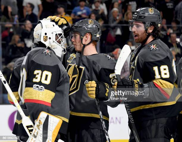 Malcolm Subban of the Vegas Golden Knights is congratulated by Cody Eakin and James Neal after the team's 31 win over the Boston Bruins at TMobile...