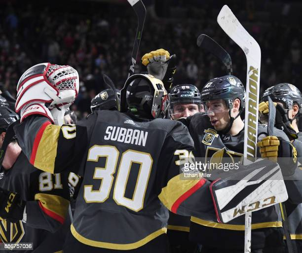 Malcolm Subban of the Vegas Golden Knights is congratulated by teammates including Shea Theodore after they defeated the Anaheim Ducks 43 in a...