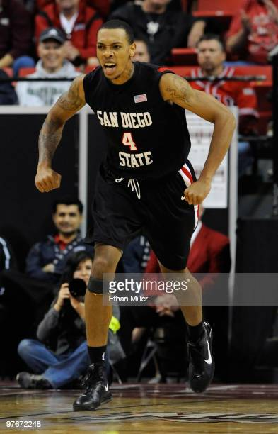 Malcolm Thomas of the San Diego State Aztecs reacts after dunking against the New Mexico Lobos during a semifinal game of the Conoco Mountain West...