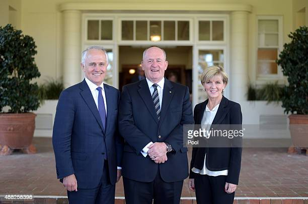 Malcolm Turnbull Australia's GovernorGeneral Sir Peter Cosgrove and Deputy leader of the LNP Julie Bishop pose for photographs after Mr Turnbull was...