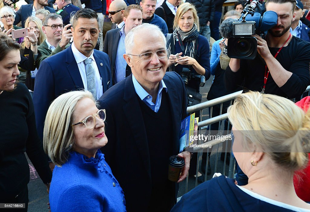 Malcolm Turnbull, Australia's prime minister, center, and his wife Lucy Turnbull, left, arrive at a polling station in Sydney, Australia, on Saturday, July 2, 2016. Turnbull is seeking another three-year term for his Liberal-National coalition in Australia's election Saturday, telling voters he can steer the world's 12th-largest economy through global headwinds and a fading commodities boom. Photographer: Jeremy Piper/Bloomberg via Getty Images
