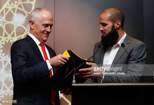 Malcolm Turnbull Prime Minister of Australia chats to Bachar Houli of the Tigers during the Bachar Houli Programs 2017 AFL Eid Celebration at Punt...