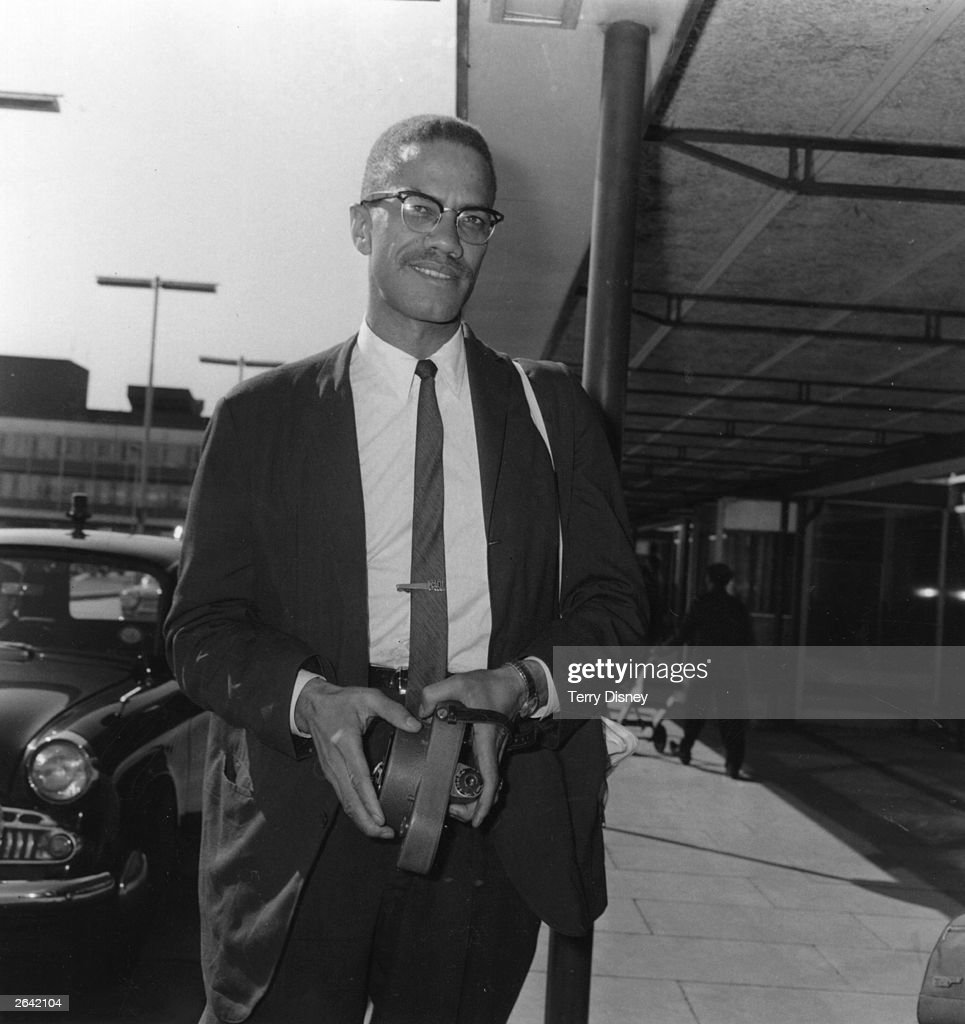 Malcolm X black American Muslim leader arriving at Heathrow Airport en route to Egypt to attend a meeting of the Organization of African Unity London...