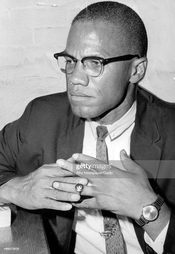 <a gi-track='captionPersonalityLinkClicked' href=/galleries/search?phrase=Malcolm+X&family=editorial&specificpeople=70045 ng-click='$event.stopPropagation()'>Malcolm X</a>, civil rights leader, wearing glasses and frowning while he wrings his hands, 1960.