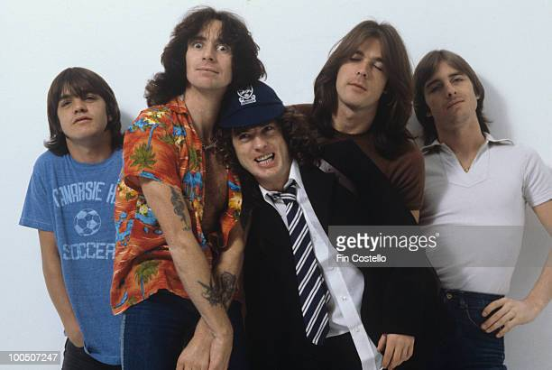 Malcolm Young Bon Scott Angus Young Cliff Williams and Phil Rudd of Australian rock band AC/DC pose in London England in August 1979