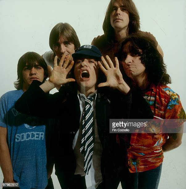 Malcolm Young Phil Rudd Angus Young Cliff Williams and Bon Scott of Australian rock band AC/DC pose in Camden London in August 1979