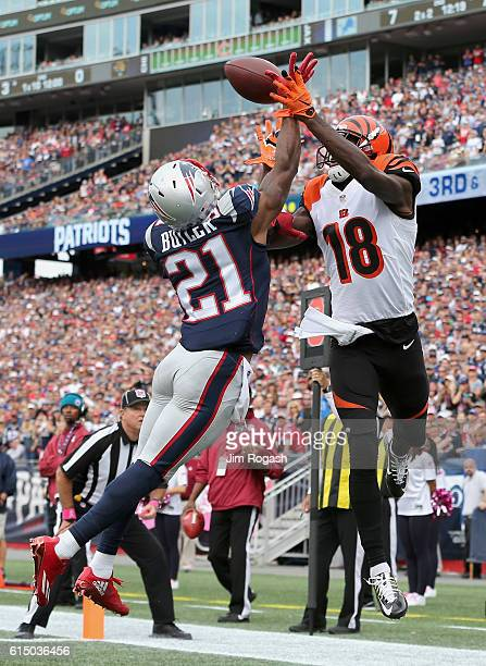 Malcom Butler of the New England Patriots blocks the pass to AJ Green of the Cincinnati Bengals during the game at Gillette Stadium on October 16...