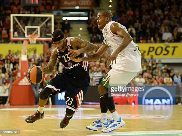 Malcom Delaney #23 of FC Bayern Munich competes with Kim English #24 of Montepaschi Siena during the 20132014 Turkish Airlines Euroleague Regular...