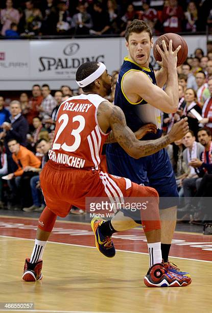 Malcom Delaney of Muenchen challenges Chris Kramer of Oldenburg during the match between FC Bayern Muenchen and EWE Baskets Oldenburg at Audi Dome on...