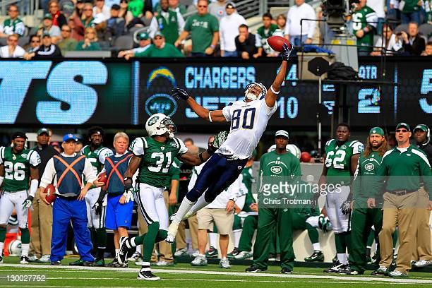 Malcom Floyd of the San Diego Chargers catches the ball over Antonio Cromartie of the New York Jets at MetLife Stadium on October 23 2011 in East...