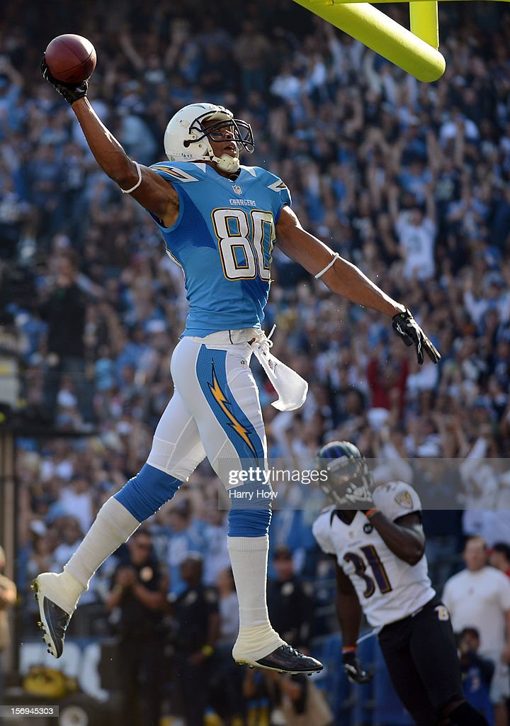 Malcom Floyd #80 of the San Diego Chargers celebrates his touchdown for a 7-0 lead with a dunk of the upright in front of Bernard Pollard #31 of the Baltimore Ravens at Qualcomm Stadium on November 25, 2012 in San Diego, California.