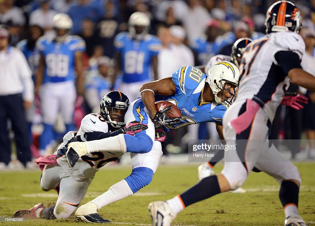 <a gi-track='captionPersonalityLinkClicked' href=/galleries/search?phrase=Malcom+Floyd&family=editorial&specificpeople=583121 ng-click='$event.stopPropagation()'>Malcom Floyd</a> #80 of the San Diego Chargers is tackled by Mike Adams #20 of the Denver Broncos after his catch at Qualcomm Stadium on October 15, 2012 in San Diego, California.