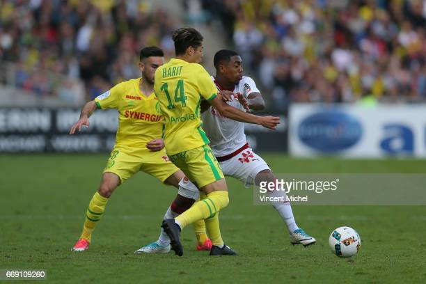Malcom of Bordeaux and Amine Harit of Nantes during the Ligue 1 match between Fc Nantes and Girondins Bordeaux at Stade de la Beaujoire on April 16...