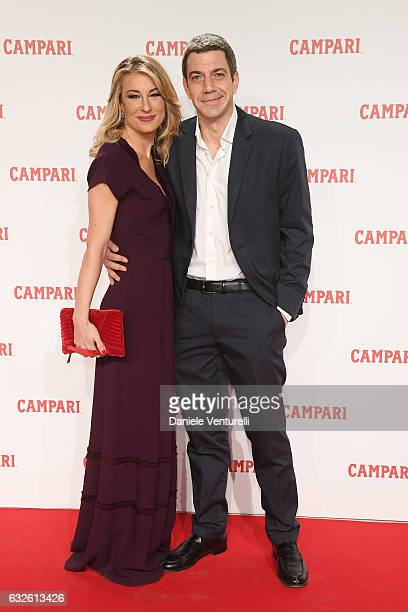 Malcom Pagani and Mia Ceran walk the red carpet for 'Campari Red Diaries Killer In Red' on January 24 2017 in Rome Italy