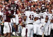 Malcome Kennedy of the Texas AM Aggies celebrates after catching a 12 yard touchdown pass in the first quarter during the game against the...