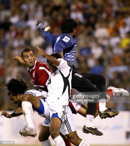 Maldives' goalkeeper Imran Mohamed tries to block Lebanon's Roda Antar during their 2006 World Cup Asian zone qualifying match in Beirut 09 June 2004...