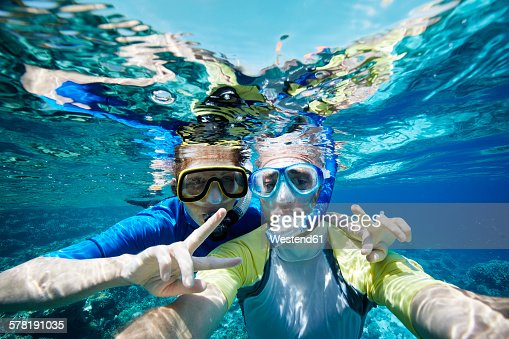Maldives, portrait of couple snorkeling in the Indian Ocean
