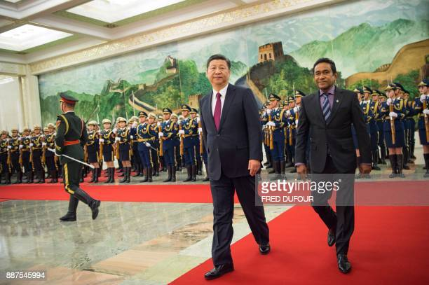 Maldives' President Abdulla Yameen and China's President Xi Jinping walk during a welcome ceremony at the Great Hall of the People in Beijing on...