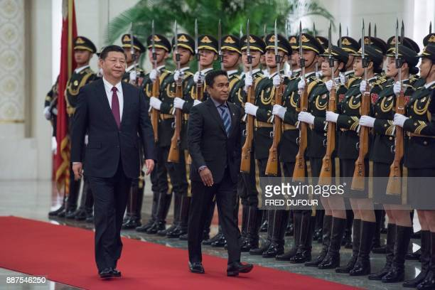 Maldives' President Abdulla Yameen and China's President Xi Jinping review the Chinese honour guard during a welcome ceremony at the Great Hall of...