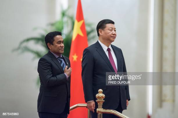 Maldives' President Abdulla Yameen and China's President Xi Jinping listen to the national anthems during a welcome ceremony at the Great Hall of the...