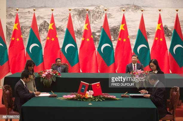 Maldives' President Abdulla Yameen attends with China's President Xi Jinping a signing ceremony at the Great Hall of the People in Beijing on...