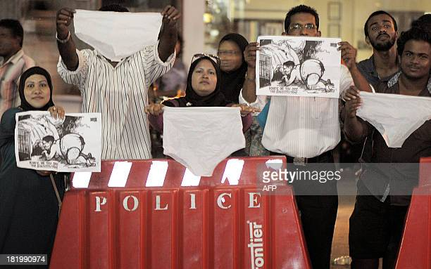 Maldivian activists wave underwear and cartoons as they stage a protest in Male late September 26 2013 Police in the Maldives said that they had...